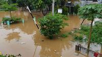 Banjir rendam permukiman di Bojongkulur, Kecamatan Gunungputri, Kabupaten Bogor, Jawa Barat. (Liputan6.com/Achmad Sudarno)