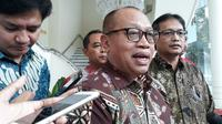 Direktur Utama BPJS Ketenagakerjaan Agus Susanto usai menemui Wakil Presiden RI Jusuf Kalla (JK), Rabu (21/3/2018). (Intan Umbari Prihatin/Merdeka.com)