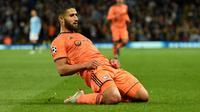 Namun Lyon membatalkan transfer Nabil Fekir ke Liverpool beralasan masih membuthkan jasa pemain kidal tersebut. Alhasil musim lalu Liverpool malah mendatangkan Xherdan Shaqiri. (AFP/Oli Scarff)