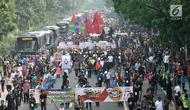 Suasana kemeriahan saat pawai Deklarasi Kampanye Damai di Monas, Minggu (23/9). Pawai dimulai dari Monas kemudian melintasi Jalan Medan Merdeka Barat dan kembali ke Monas. (Merdeka.com/Iqbal Nugroho)