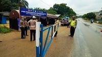 Portal penyekat untuk larangan mudik lebaran di perbatasan Riau-Sumatra Utara. (Liputan6.com/Istimewa)