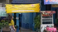 Penerapan PSBB di Malang tinggal di selangkah lagi. Kampung - kampung di Malang sendiri sudah menerapkan karantina mandiri sejak wabah Corona Covid-19 (Liputan6.com/Zainul Arifin)
