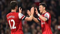 Kerjasama apik antara Olivier Giroud dan Mesut Ozil berikan kemenangan Arsenal 2-0 atas Bournemouth.