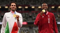 Kedua atlet tersebut harus berbagi podium utama setelah masing-masing mencatatkan lompatan yang sama setinggi 2,37 meter. Kedua atlet kemudian gagal melakukan lompatan 2,39 meter masing-masing tiga kali. (Foto: AFP/Ina Fassbender)