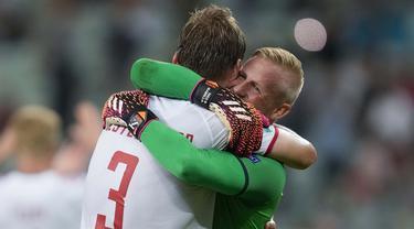 Timnas Denmark berhasil melaju ke babak semifinal Euro 2020 usai mematahkan tren positif Timnas Republik Ceska di pertandingan babak perempat final Euro 2020. Denmark lolos ke semifinal untuk pertama kalinya sejak 1992. (Foto: AP/Pool/Darko Vojinovic)