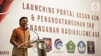 Menkominfo Johnny G. Plate memberikan sambutan saat penandatangan kerja sama pembuatan portal aduan untuk aparatur sipil negara (ASN) di Jakarta, Selasa (12/11/2019). Portal beralamat aduanasn.id. ini untuk melaporkan ASN terkait dengan penanganan radikalisme(Liputan6.com/Faizal Fanani)