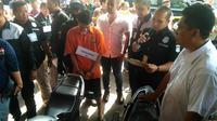 Rekonstruksi pengeroyokan TNI di Polda Metro Jaya. (Merdeka.com/Ronald)