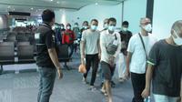 Ratusan mantan tahanan atau ex Deteni Malaysia, akhirnya bisa pulang dan tiba di Terminal 3 Bandara Internasional Soekarno Hatta (Soetta), Sabtu (7/11/2020). (Foto: Liputan6/Pramita Tristiawati)