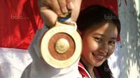 Atlet Senam Artistik, Rifda Irfanaluthfi meraih emas pada senam artistik nomor balok keseimbangan di MATRADE Exhibition and Convention Centre, Segambut, Rabu (23/8/2017). Rifda meraih nilai total 13. (Bola.com/Nicklas Hanoatubun)