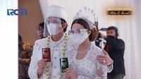 """""""Saya terima nikah dan kawinnya Titania Aurelie Nur Hermansyah bin Anang Hermansyah dengan mas kawin tersebut, tunai,"""" ucap Atra Halilintar. (Livestreaming RCTI)"""