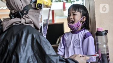 FOTO: Imunisasi Anak Sekolah di Masa Pandemi COVID-19