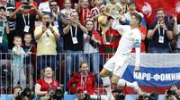Striker Portugal, Cristiano Ronaldo, melakukan selebrasi usai mencetak gol ke gawang Maroko pada laga Piala Dunia di Stadion Luzhniki, Rabu (20/6/2018). Ronaldo menjadi pencetak gol internasional terbanyak di Eropa dengan 85 gol. (AP/Antonio Calanni)
