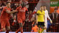 Gelandang Liverpool, Mamadou Sakho, saat merayakan golnya ke gawang Borussia Dortmund, pada laga leg kedua perempat final Liga Europa, di Anfield, Kamis atau Jumat (15/4/2016) dini hari WIB. (AFP/Oli Scarff).