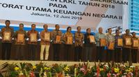 Menteri Keuangan Sri Mulyani menerima laporan hasil pemeriksaan atas laporan keuangan kementerian Tahun 2018 di bidang perekonomian dan perencanaan pembangunan dari Badan Pemeriksa Keuangan (BPK).