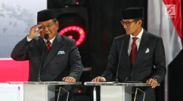 Ekspresi Prabowo - Sandiaga Uno Saat Debat Kelima Pilpres 2019