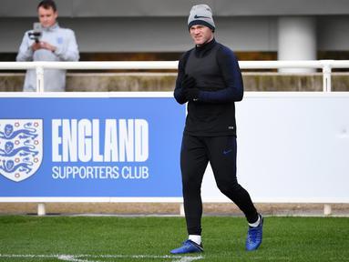 Mantan kapten timnas Inggris, Wayne Rooney bersiap memainkan laga terakhirnya bersama the Three Lions tengah pekan ini. Rooney berjanji akan tampil maksimal di depan pendukung timnas Inggris. (AFP/Paul Ellis)