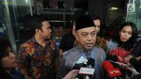 Mantan Wakil Ketua Banggar DPR Tamsil Linrung menjawab pertanyaan wartawan usai menjalani pemeriksaan di KPK, Jakarta, Rabu (4/7).Tamsil diperiksa sebagai saksi terkait kasus dugaan korupsi proyek KTP Elektronik. (Merdeka.com/Dwi Narwoko)