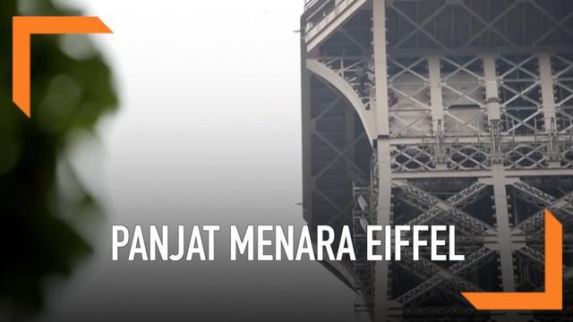 Seorang pria memanjat Menara Eiffel, Paris. Petugas melakukan negosisasi dengan pria tersebut agar turun. Selama negosiasi beralngsung, Menara Eiffel ditutup sementara.