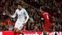 Inggris menaklukkan Portugal, 1-0, pada laga persahabatan di Stadion Wembley, London, Kamis (2/6/2016). Gol semata wayang The Three Lions dicetak Chris Smalling. (AFP/Adrian Dennis)
