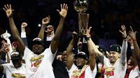 Ekspresi para pemain Toronto Raptors setelah mengalahkan Golden State Warriors pada gim keenam NBA Finals 2019 di Oracle Arena, Jumat (14/6/2019) pagi WIB. (AFP/Ezra Shaw)