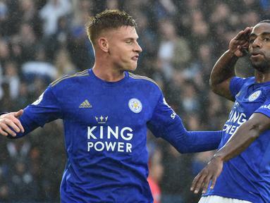 Pemain Leicester City Ricardo Pereira (kanan) melakukan selebrasi usai mencetak gol ke gawang Newcastle United pada pertandingan Liga Inggris di Stadion King Power, Leicester, Inggris, Minggu (29/9/2019). Leicester membantai Newcastle 5-0. (AP Photo/Rui Vieira)