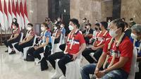 Atlet bulu tangkis Indonesia setelah tiba dari Inggris untuk mengikuti All England 2021. (Liputan6.com/Pramita Tristiawati)