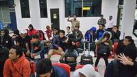 TKI korban perdagangan orang di Korsel tiba di Bandara Soetta  (Liputan6.com/ Pramitha Tristiawati)