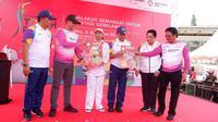 Menteri BUMN Rini M Soemarno,  Dirut Telkomsel Ririek Adriansyah, dan Direktur Enterprise dan Business Service Telkom Dian Rachmawan. (Doc: Telkomsel)