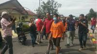 Dua orang Aparatur Sipil Negara (ASN) di Kabupaten Simalungun, Sumatera Utara (Sumut), diamankan pihak kepolisian karena terkait kasus video mesum. (Liputan6.com/Reza Efendi)