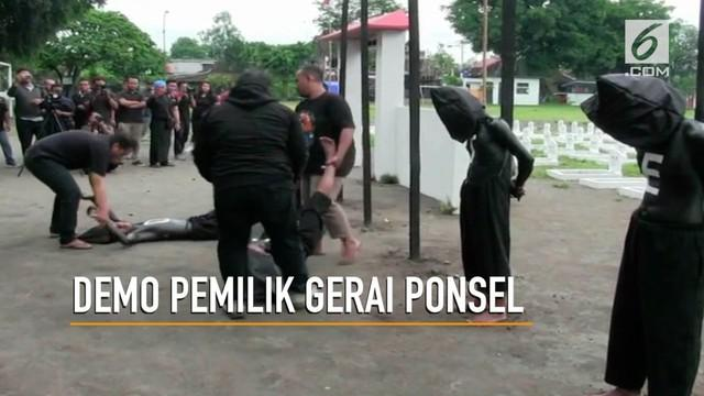 Ratusan pemilik gerai ponsel di Yogyakarta menggelar aksi demonstrasi.