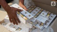 Barang bukti hasil penindakan barang kena cukai di Kantor Pusat Bea Cukai, Jakarta Timur, Jumat (25/10/2019). Ditjen Bea dan Cukai Kementerian Keuangan merilis hasil tindakan produk-produk ilegal, di antaranya rokok elektrik, rokok, hingga minuman keras . (Liputan6.com/Immanuel Antonius)