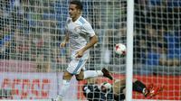 Aksi pemain Real Madrid, Lucas Vazquez usai membobol gawang Numancia pada laga Copa Del Rey di Santiago Bernabeu stadium, Madrid, (10/01/2018). Real Madrid unggul agregat 5-2 atas Numancia. (AP/Francisco Seco)