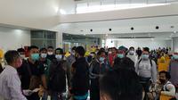 Pekerja migran dari Malaysia tiba di Indonesia (Foto: Liputan6.com/Dian Kurniawan)