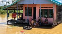 Banjir melanda 14 desa di Kabupaten Berau akibat sungai meluap.