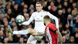 Gareth Bale - Bersama Benzema dan Cristiano Ronaldo mereka membentuk trio BBC yang fantastis dan membawa Real Madrid berjaya di Liga Champions. Bale sendiri telah membukukan 16 gol dalam 55 pertandingan Liga Champions bersama Los Blancos. (AFP/Javier Soriano)