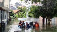 Banjir di Kecamatan Tanah Sareal, Kota Bogor terus meluas. (Achmad Sudarno/Liputan6.com).