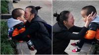 Foto seorang wanita yang menangis sambil memeluk anaknya di depan halaman rumah sakit ini pun langsung viral dan menjadi perhatian masyarakat. (Foto: kuaibao.qq.com)