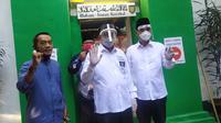Pasangan calon wali dan wakil wali kota Surabaya, Machfud Arifin-Mujiaman. (Liputan6.com/ Dian Kurniawan)