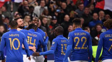 Perayaan gol Antoine Griezmann pada laga kedua Kualifikasi Piala Eropa 2020 Grup H yang berlangsung di Stadion Stade de France, Paris, Selasa (26/3). Perancis menang 4-0 atas Islandia. (AFP/Franck Fife)