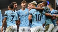 Selebrasi gol yang dicetak Sergio Aguero pada laga lanjutan Premier League yang berlangsung di stadion Etihad, Manchester, Minggu (10/2). Manchester City menang 6-0 atas Chelsea. (AFP/Oli Scarff)