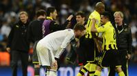 Bek Real Madrid Sergio Ramos usai disingkirkan Borussia Dortmund di semifinal Liga Champions 2013/2014. (AFP/Javier Soriano)