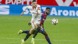 Penyerang Sevilla, Youssef En-Nesyri (kiri), berada di urutan ke-5 dengan kecepatan sprintnya mencapai kecepatan tertinggi 33,1 km / jam di Liga Champions UEFA musim ini. (Foto: AP/Angel Fernandez)