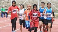 Pekan Olahraga Rakyat Aceh (PORA) XIII 2018 di Kota Jantho Kabupaten Aceh Besar yang berakhir Minggu, 25 November 2018, sempat mendapat cibiran karena ada sejumlah atlet tidak menutup aurat. (Liputan6.com/Rino Abonita)