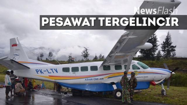 Pesawat diduga tergelincir akibat cuaca buruk dan landasan yang licin.