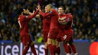 Selebrasi gol Mohamed Salah pada leg kedua babak perempat final Liga Champions yang berlangsung di Stadion do Dragao, Porto, Kamis (17/4). Liverpool menang 4-1 atas Porto. (AFP/Paul Ellis)