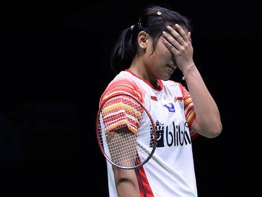 Tunggal putri Indonesia, Gregoria Mariska Tunjung bereaksi setelah kehilangan satu poin melawan pebulu tangkis Taiwan, Tai Tzu Ying pada babak perempat final Piala Sudirman 2019 di Nanning, China, Jumat (24/5/2019). Gregoria Mariska kalah dua gim langsung 16-21, 14-21. (WANG ZHAO/AFP)
