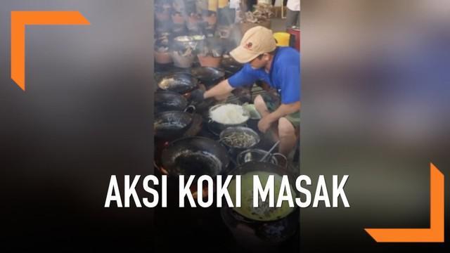 Seorang koki memasak 5 ribu panekuk dalam sehari di sebuah kuil di Vietnam. Ia menggunakan 12 wajan secara bersamaan.