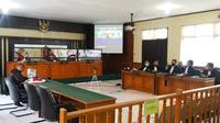 Sidang korupsi mantan Plt Sekda Kuansing di Pengadilan Tipikor Pekanbaru. (Liputan6.com/M Syukur)