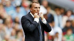 Brendan Rodgers - Baru-baru ini terhembus kabar bahwa pemilik baru Newcastle telah mencoba untuk menggoda Brendan Rodgers meninggalkan Leicester City. Dengan dalih tantangan baru dan segudang materi dari The Magpies bisa saja ia membelot ke St James Park. (AFP/Adrian Dennis)