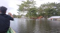 Banjir Konawe, merendam rumah warga hingga setinggi 2 meter.(Liputan6.com/Ahmad Akbar Fua)